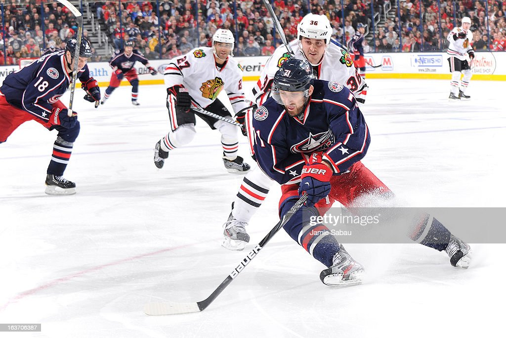 <a gi-track='captionPersonalityLinkClicked' href=/galleries/search?phrase=Nick+Foligno&family=editorial&specificpeople=537821 ng-click='$event.stopPropagation()'>Nick Foligno</a> #71 of the Columbus Blue Jackets controls the puck during the third period on March 14, 2013 at Nationwide Arena in Columbus, Ohio. Chicago defeated Columbus 2-1 in a shootout.
