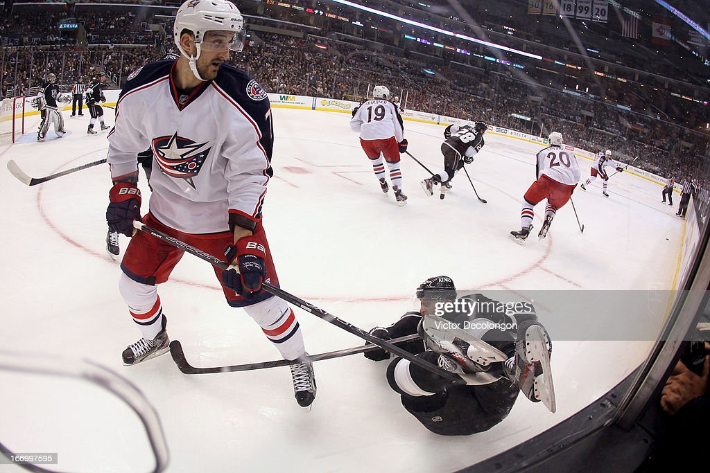 <a gi-track='captionPersonalityLinkClicked' href=/galleries/search?phrase=Nick+Foligno&family=editorial&specificpeople=537821 ng-click='$event.stopPropagation()'>Nick Foligno</a> #71 of the Columbus Blue Jackets gets his stick under the skates of <a gi-track='captionPersonalityLinkClicked' href=/galleries/search?phrase=Trevor+Lewis&family=editorial&specificpeople=543187 ng-click='$event.stopPropagation()'>Trevor Lewis</a> #22 of the Los Angeles Kings as the play moves up ice in the third period during the NHL game at Staples Center on April 18, 2013 in Los Angeles, California. The Kings defeated the Blue Jackets 2-1.