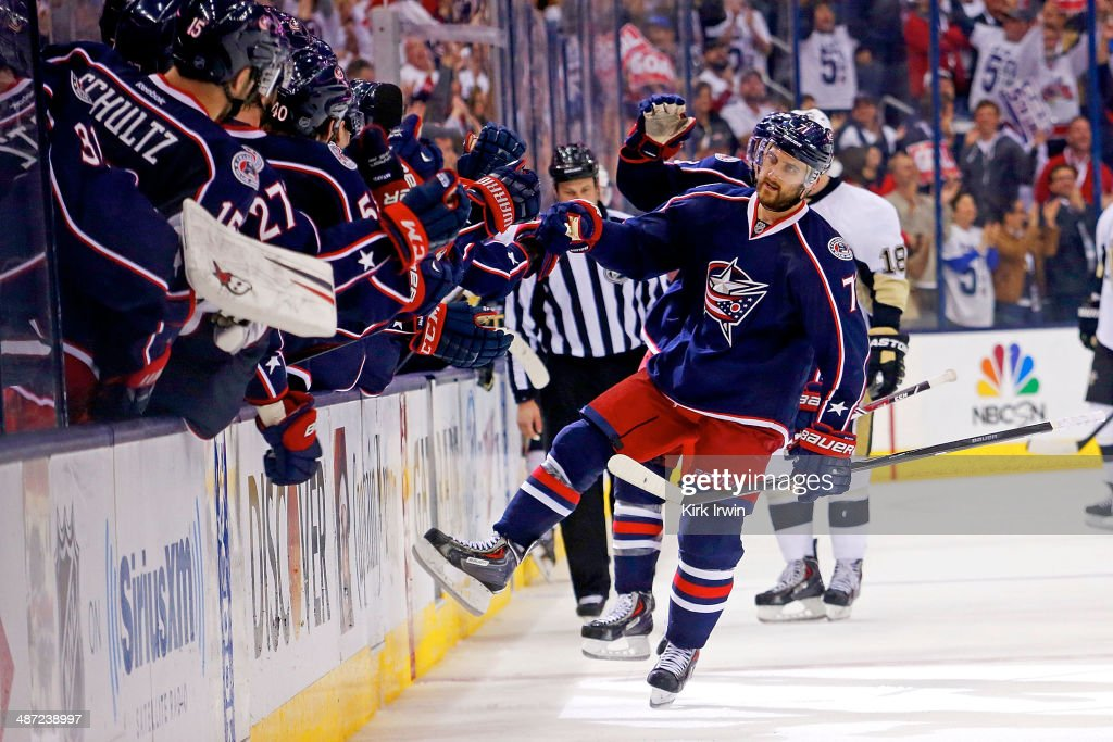 <a gi-track='captionPersonalityLinkClicked' href=/galleries/search?phrase=Nick+Foligno&family=editorial&specificpeople=537821 ng-click='$event.stopPropagation()'>Nick Foligno</a> #71 of the Columbus Blue Jackets is congratulated by his teammates after scoring a goal against the Pittsburgh Penguins during the third period of Game Six of the First Round of the 2014 NHL Stanley Cup Playoffs at Nationwide Arena on April 28, 2014 in Columbus, Ohio. Pittsburgh defeated Columbus 4-3 to win the series four games to two.