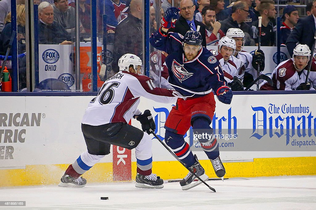Nick Foligno #71 of the Columbus Blue Jackets jumps past Cory Sarich #16 of the Colorado Avalanche in order to continue chasing after the puck during the second period on April 1, 2014 at Nationwide Arena in Columbus, Ohio.