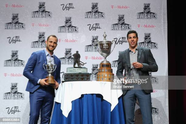 Nick Foligno of the Columbus Blue Jackets poses with the King Clancy Memorial Trophy and the Mark Messier Leadership Award as Travis Hamonic of the...