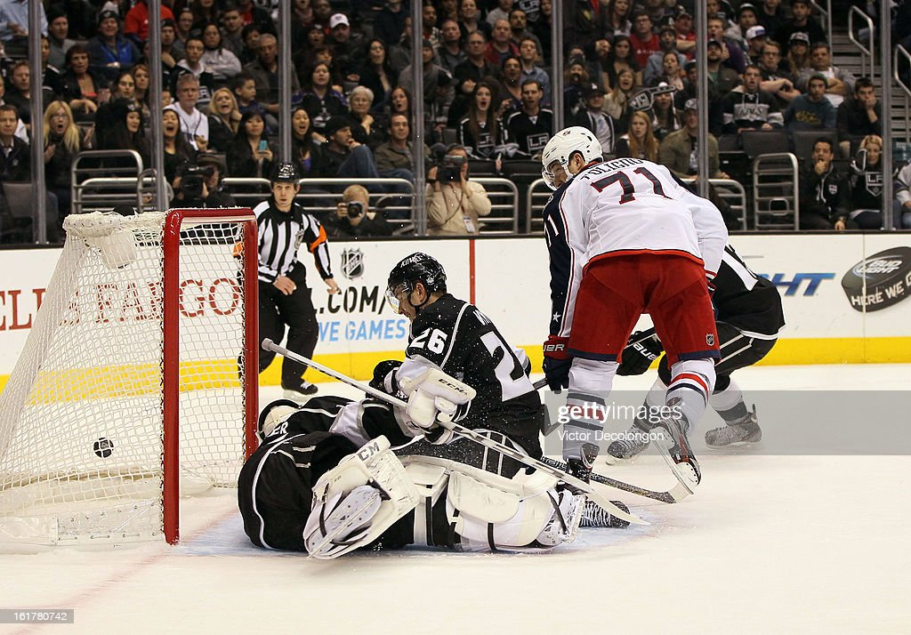 Nick Foligno #71 of the Columbus Blue Jackets scores against goaltender Jonathan Bernier #45 of the Los Angeles Kings as defenseman Slava Voynov #26 of the Los Angeles Kings fails to defend the play during the NHL game at Staples Center on February 15, 2013 in Los Angeles, California. The Kings defeated the Blue Jackets 2-1.