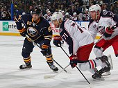 Nick Foligno of the Columbus Blue Jackets skates alongside his brother Marcus Foligno of the Buffalo Sabres on October 9 2014 at the First Niagara...