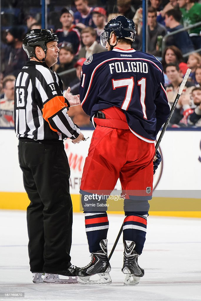 Nick Foligno #71 of the Columbus Blue Jackets talks with referee Dan O'Halloran #13 during a game against the New York Rangers on November 7, 2013 at Nationwide Arena in Columbus, Ohio.