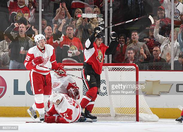 Nick Foligno of the Ottawa Senators celebrates his second period goal against Niklas Kronwall and Valtteri Filppula of the Detroit Red Wings at...