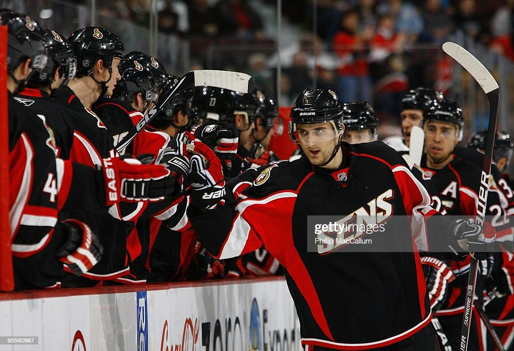 Nick Foligo of the Ottawa Senators celebrates a goal against the Colorado Avalanche with his teammates on the bench in a game at Scotiabank Place on...