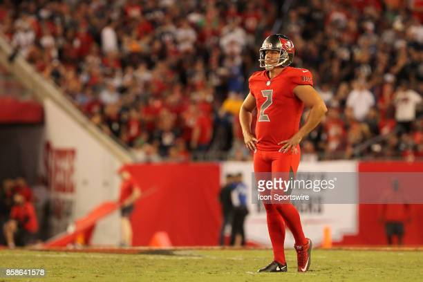 Nick Folk of the Bucs has a moment to think about things before missing a field goal during the NFL Regular game between the New England Patriots and...