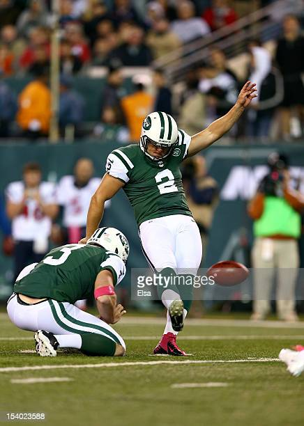 Nick Folk of the New York Jets attempts a kick against the Houston Texans at MetLife Stadium on October 8 2012 in East Rutherford New Jersey