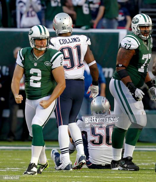 Nick Folk of the New York Jets celebrates his gamewinning field goal for a 3027 win against the New England Patriots during their game at MetLife...