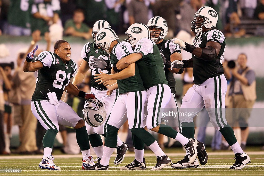 Nick Folk #2 of the New York Jets celebrates with teammates <a gi-track='captionPersonalityLinkClicked' href=/galleries/search?phrase=Dustin+Keller&family=editorial&specificpeople=2160327 ng-click='$event.stopPropagation()'>Dustin Keller</a> #81, <a gi-track='captionPersonalityLinkClicked' href=/galleries/search?phrase=Mark+Brunell&family=editorial&specificpeople=201667 ng-click='$event.stopPropagation()'>Mark Brunell</a> #8 and <a gi-track='captionPersonalityLinkClicked' href=/galleries/search?phrase=Brandon+Moore&family=editorial&specificpeople=241545 ng-click='$event.stopPropagation()'>Brandon Moore</a> #65 of the New York Jets after FOlk kicked a successful 50-yard game-winning field goal against the Dallas Cowboys during their NFL Season Opening Game at MetLife Stadium on September 11, 2011 in East Rutherford, New Jersey.