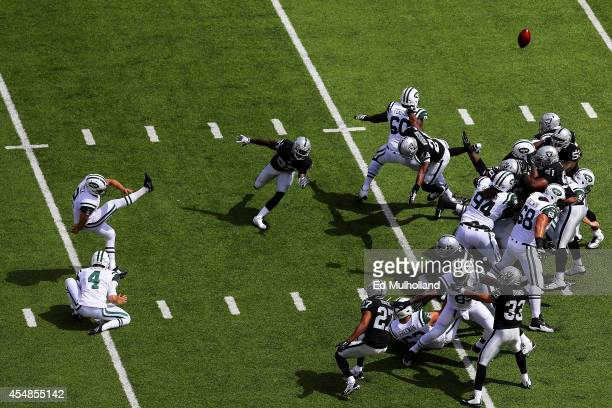 Nick Folk of the New York Jets kicks a field goal against the Oakland Raiders in the first quarter at MetLife Stadium on September 7 2014 in East...