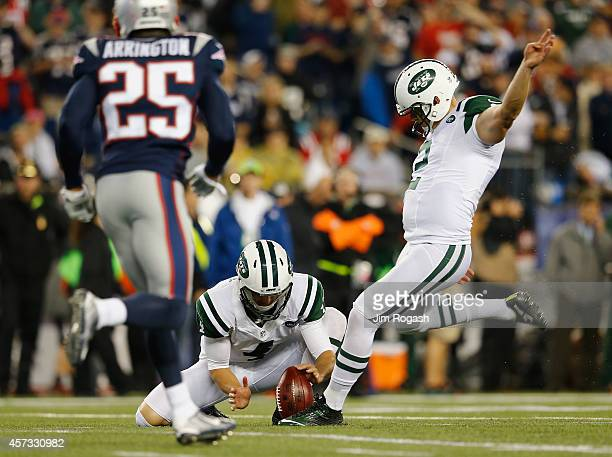 Nick Folk of the New York Jets kicks a field goal during the first quarter against the New England Patriots at Gillette Stadium on October 16 2014 in...