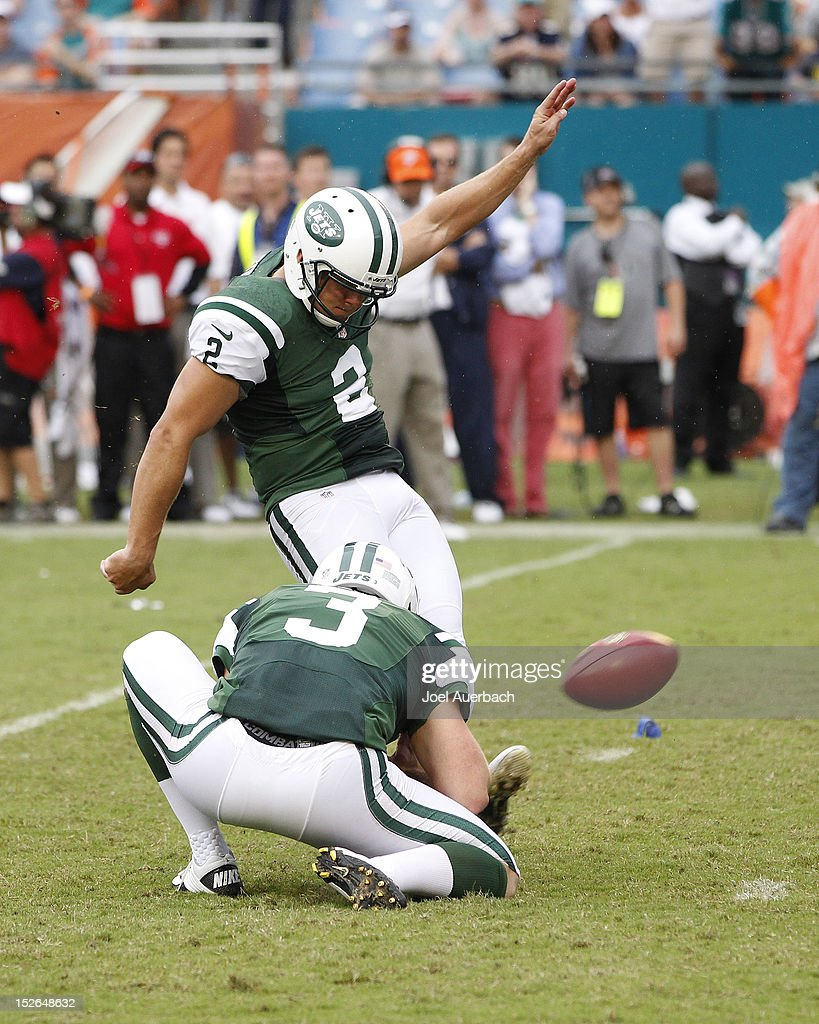 Nick Folk #2 of the New York Jets kicks the game winning field goal in overtime against the Miami Dolphins on September 23, 2012 at Sun Life Stadium in Miami Gardens, Florida. The Jets defeated the Dolphins 23-20 in overtime.