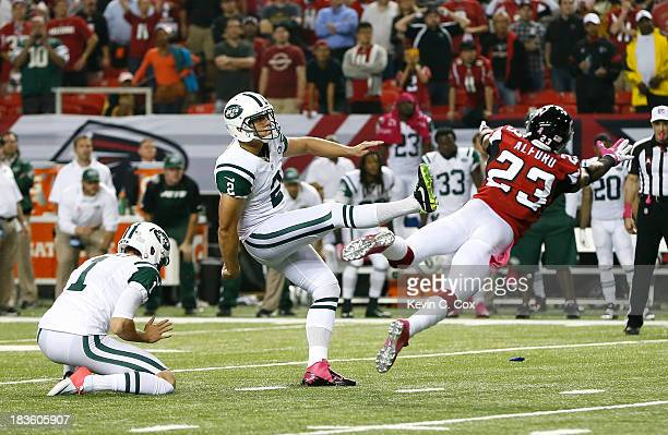 Nick Folk of the New York Jets kicks the gamewinning field goal as time expires against the Atlanta Falcons at Georgia Dome on October 7 2013 in...