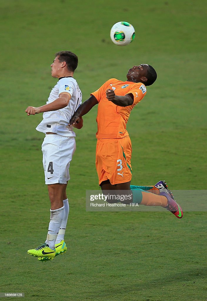 Nick Forrester of New Zealand goes up with Meite Yakou of Ivory Coast during the FIFA U-17 World Cup UAE 2013 Group B match between New Zealand and Ivory Coast at the Mohamed Bin Zayed Stadium on October 23, 2013 in Abu Dhabi, United Arab Emirates.