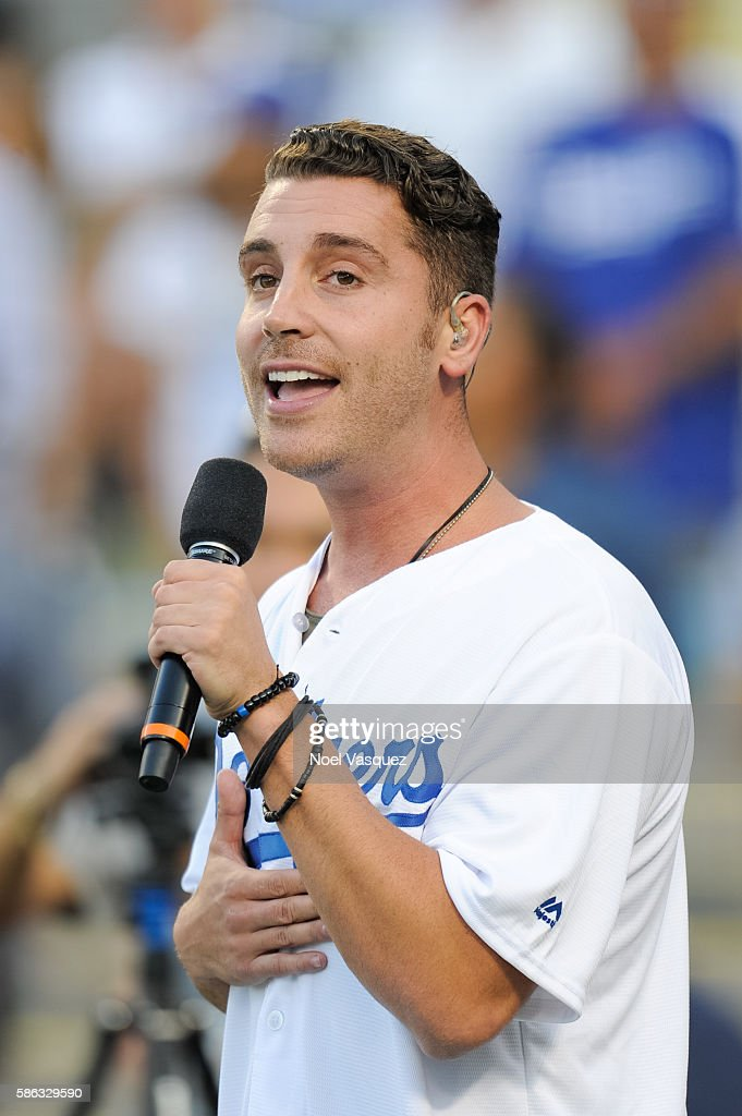 Nick Fradiani performs the national anthem prior to a baseball game between the Boston Red Sox and the Los Angeles Dodgers at Dodger Stadium on...
