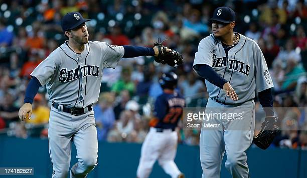 Nick Franklin and Felix Hernandez of the Seattle Mariners celebrate a play to end the fifth inning against the Houston Astros at Minute Maid Park on...