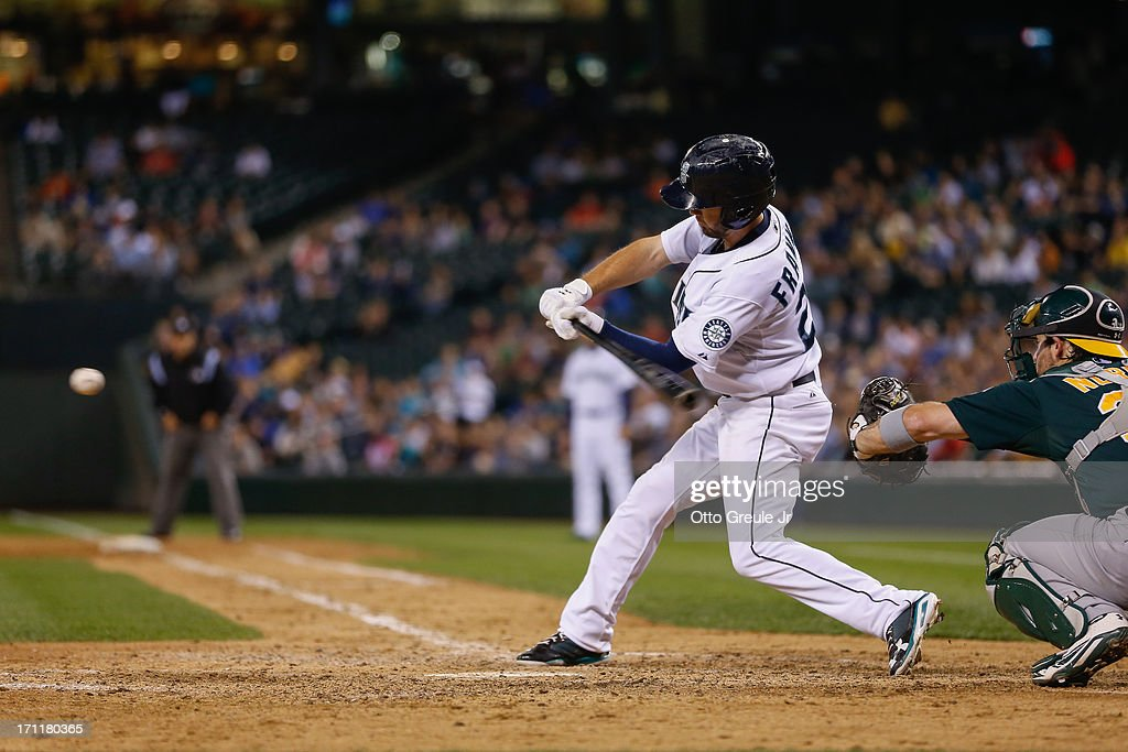 Nick Franklin #20 of the Seattle Mariners hits a two-RBI single in the eighth inning against the Oakland Athletics at Safeco Field on June 22, 2013 in Seattle, Washington.