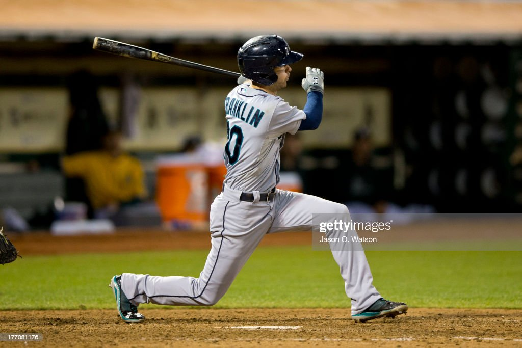<a gi-track='captionPersonalityLinkClicked' href=/galleries/search?phrase=Nick+Franklin&family=editorial&specificpeople=3092191 ng-click='$event.stopPropagation()'>Nick Franklin</a> #20 of the Seattle Mariners hits an RBI single against the Oakland Athletics during the eighth inning at O.co Coliseum on August 20, 2013 in Oakland, California.