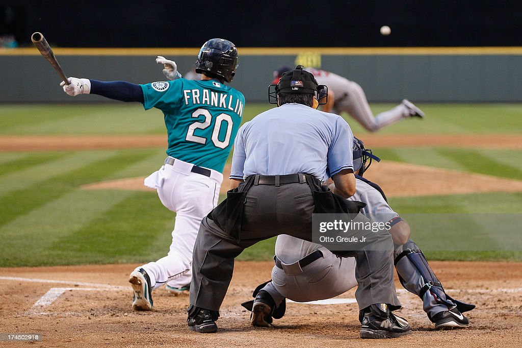 <a gi-track='captionPersonalityLinkClicked' href=/galleries/search?phrase=Nick+Franklin&family=editorial&specificpeople=3092191 ng-click='$event.stopPropagation()'>Nick Franklin</a> #20 of the Seattle Mariners hits an RBI single in the fifth inning against the Minnesota Twins at Safeco Field on July 26, 2013 in Seattle, Washington.