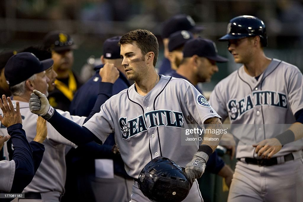 <a gi-track='captionPersonalityLinkClicked' href=/galleries/search?phrase=Nick+Franklin&family=editorial&specificpeople=3092191 ng-click='$event.stopPropagation()'>Nick Franklin</a> #20 of the Seattle Mariners is congratulated by teammates after hitting a two run home run against the Oakland Athletics during the third inning at O.co Coliseum on August 20, 2013 in Oakland, California.