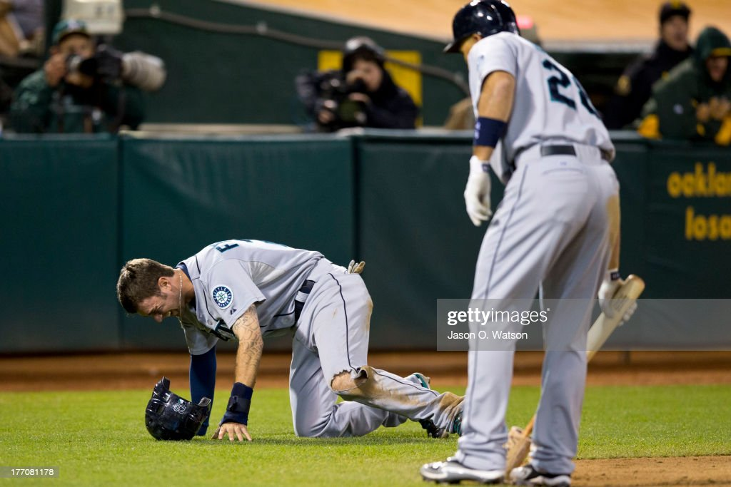 <a gi-track='captionPersonalityLinkClicked' href=/galleries/search?phrase=Nick+Franklin&family=editorial&specificpeople=3092191 ng-click='$event.stopPropagation()'>Nick Franklin</a> #20 of the Seattle Mariners is injured in a collision at home plate with Derek Norris of the Oakland Athletics (not pictured) to score a run during the eighth inning at O.co Coliseum on August 20, 2013 in Oakland, California.