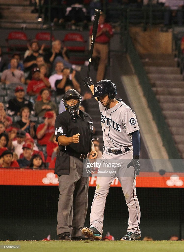 <a gi-track='captionPersonalityLinkClicked' href=/galleries/search?phrase=Nick+Franklin&family=editorial&specificpeople=3092191 ng-click='$event.stopPropagation()'>Nick Franklin</a> #20 of the Seattle Mariners reacts after striking out in the eighth inning as MLB home plate umpire <a gi-track='captionPersonalityLinkClicked' href=/galleries/search?phrase=Kerwin+Danley&family=editorial&specificpeople=211350 ng-click='$event.stopPropagation()'>Kerwin Danley</a> #44 calls Franklin out during the MLB game against the Los Angeles Angels of Anaheim at Angel Stadium of Anaheim on June 19, 2013 in Anaheim, California. The Angels defeated the Mariners 1-0.