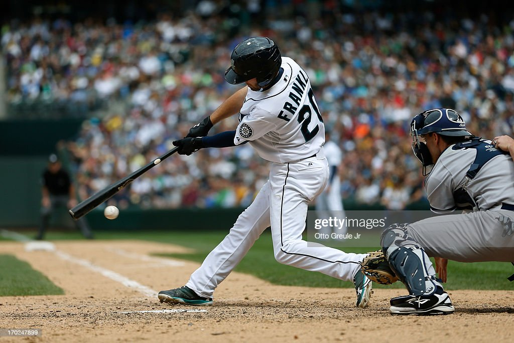 <a gi-track='captionPersonalityLinkClicked' href=/galleries/search?phrase=Nick+Franklin&family=editorial&specificpeople=3092191 ng-click='$event.stopPropagation()'>Nick Franklin</a> #20 of the Seattle Mariners strikes out with a runner at third to end the eighth inning against the New York Yankees at Safeco Field on June 9, 2013 in Seattle, Washington.