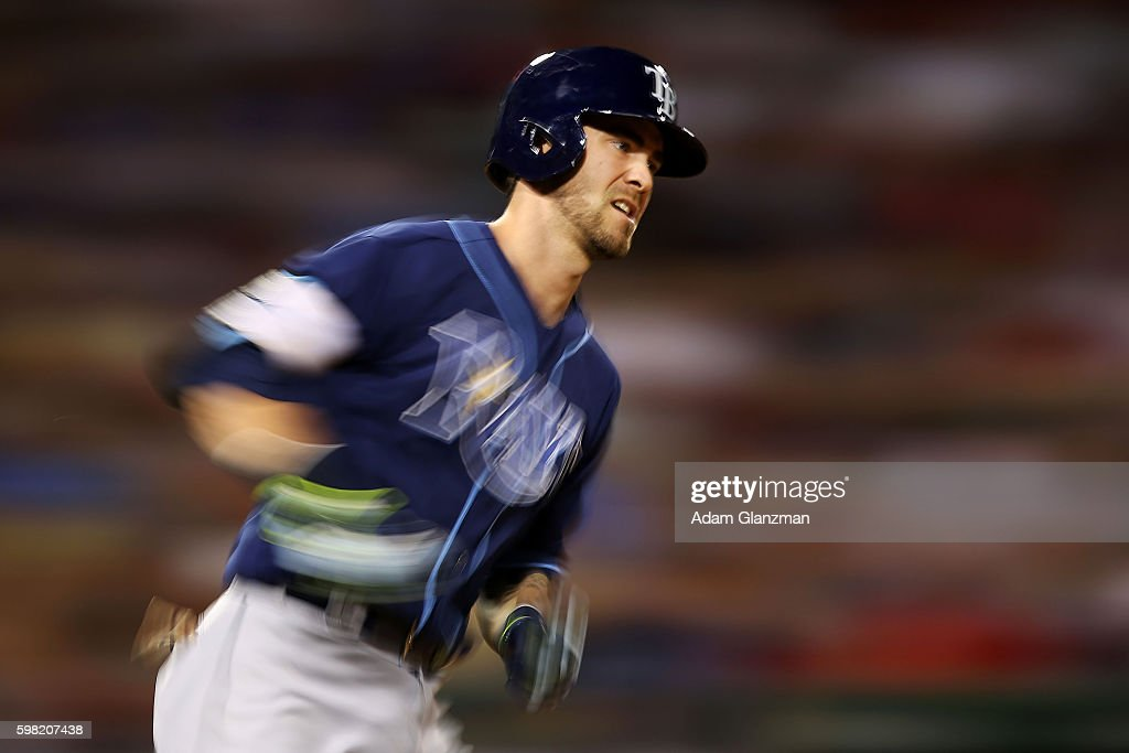 Nick Franklin of the Tampa Bay Rays runs to first base in the seventh inning during a game against the Boston Red Sox at Fenway Park on August 29...