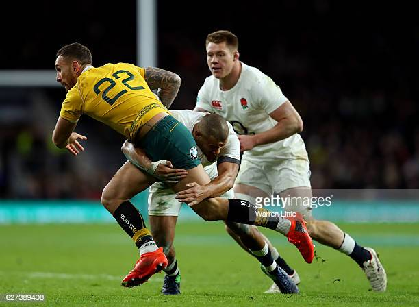 Nick Frisby of Australia is tackled by Jonathan Joseph of England during the Old Mutual Wealth Series match between England and Australia at...