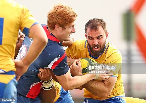 Nick Frisby of City is tackled by Nic Stirzaker of the Rising during the round four NRC match between Melbourne Rising and Brisbane City at...