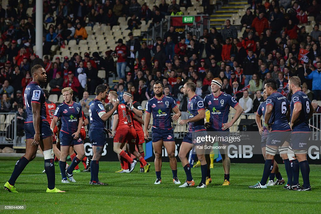 Nick Frisby of the Reds (C) and his teammates look dejected after conceding a try during the round 11 Super Rugby match between the Crusaders and the Reds at AMI Stadium on May 6, 2016 in Christchurch, New Zealand.