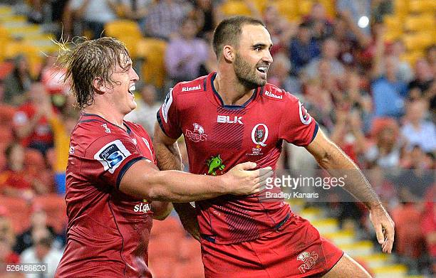 Nick Frisby of the Reds celebrates scoring a try during the round 10 Super Rugby match between the Reds and the Cheetahs at Suncorp Stadium on April...