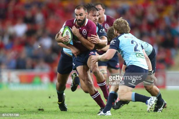 Nick Frisby of the Reds is tackled during the round 10 Super Rugby match between the Reds and the Waratahs at Suncorp Stadium on April 29 2017 in...