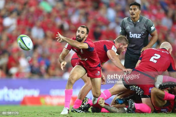 Nick Frisby of the Reds passes during the round three Super Rugby match between the Reds and the Crusaders at Suncorp Stadium on March 11 2017 in...