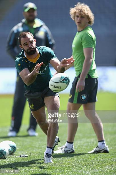 Nick Frisby of the Wallabies passes during the Australia Wallabies captain's run at Eden Park on October 21 2016 in Auckland New Zealand