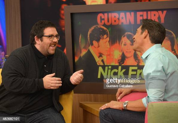 Nick Frost and Johnny Lozada on the set of Despierta America at Univision Headquarters on April 4 2014 in Miami Florida