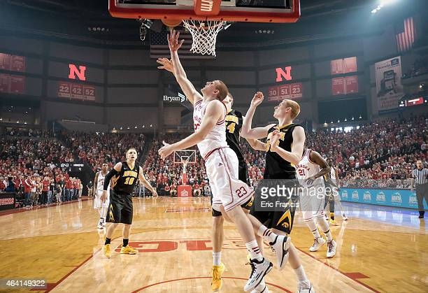 Nick Fuller of the Nebraska Cornhuskers lays the ball up over Adam Woodbury and Aaron White of the Iowa Hawkeyes during their game at Pinnacle Bank...