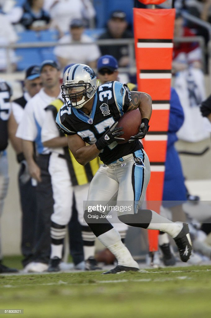Nick Goings #37 of the Carolina Panthers carries the ball during the game against the Oakland Raiders at Bank of America Stadium on November 7, 2004 in Charlotte, North Carolina.