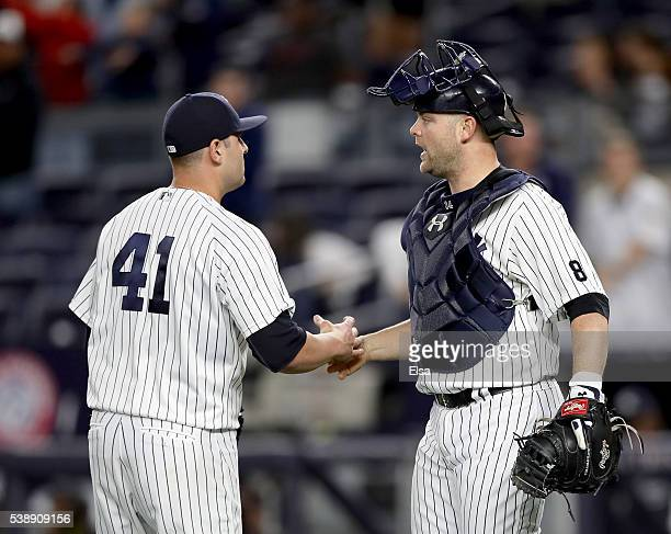 Nick Goody and Brian McCann of the New York Yankees celebrate the win over the Los Angeles Angels at Yankee Stadium on June 8 2016 in the Bronx...