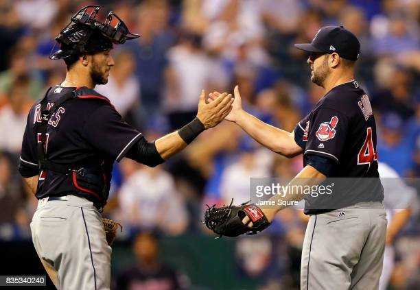 Nick Goody and Yan Gomes of the Cleveland Indians congratulate each other after the Indians defeated the Kansas City Royals 101 to win the game at...