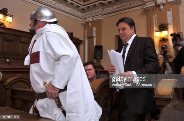 Nick Griffin arrives with a man dressed as Saint George at the Civic Centre in Stoke as the British National Party launch their 2010 General Election...