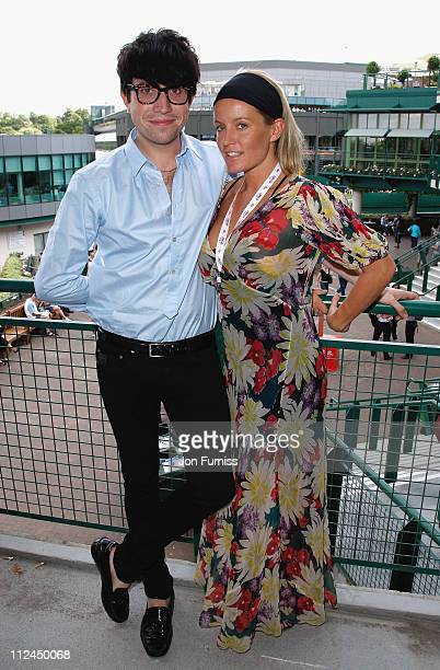 DJ Nick Grimshaw and actress Davinia Taylor on the balcony of the Evian VIP Suite during the Wimbledon Championships 2008 at the All England Club on...
