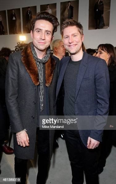 Nick Grimshaw and Burberry Chief Creative Officer Christopher Bailey pose backstage during the Burberry AW14 Menswear Show at Kensington Gardens on...
