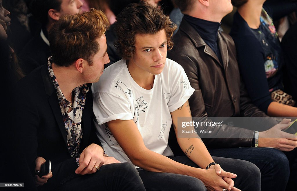 Nick Grimshaw and Harry Styles attend the Fashion East show during London Fashion Week SS14 at TopShop Show Space on September 17, 2013 in London, England.