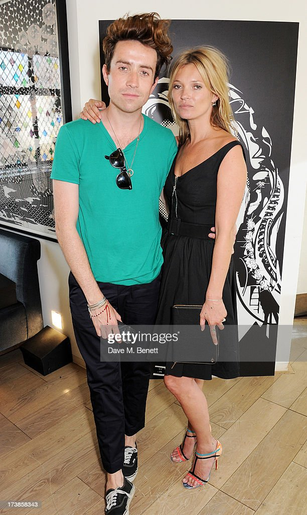 Nick Grimshaw (L) and Kate Moss attend a first look at a new range of tech accessories for Carphone Warehouse, designed exclusively by Kate Moss for the high street brand, at The Club at The Ivy on July 18, 2013 in London England. The range of smartphone and tablet accessories goes on sale nationwide later this month.
