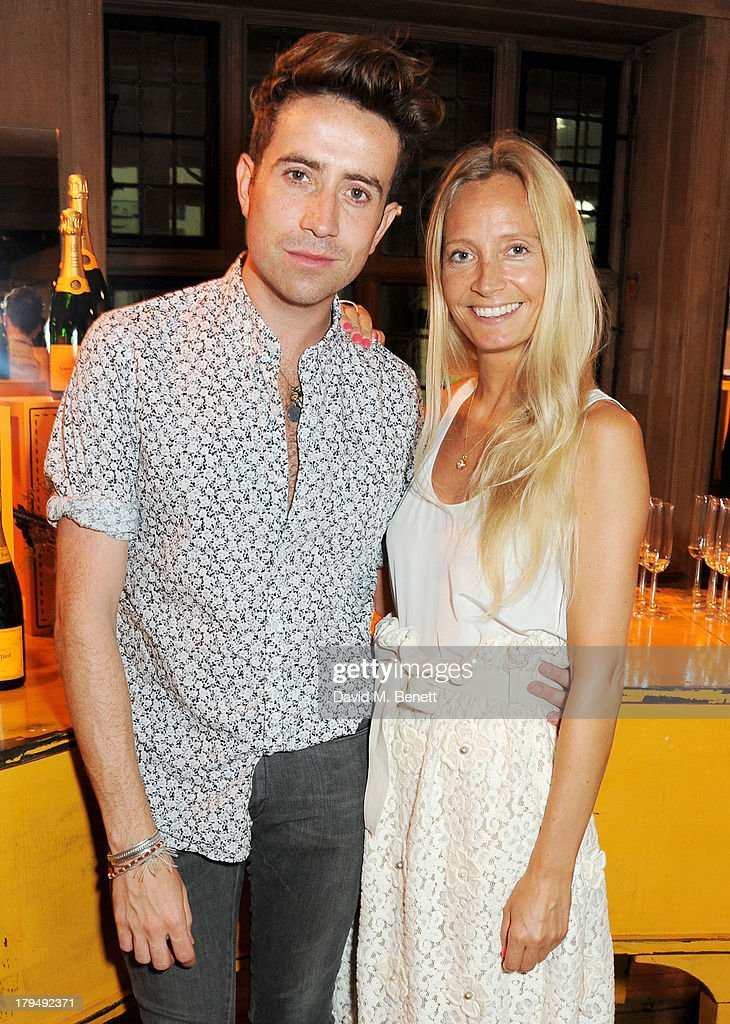 Nick Grimshaw (L) and Martha Ward attend the launch of Alexa Chung's first book 'It' at Liberty on September 4, 2013 in London, England.