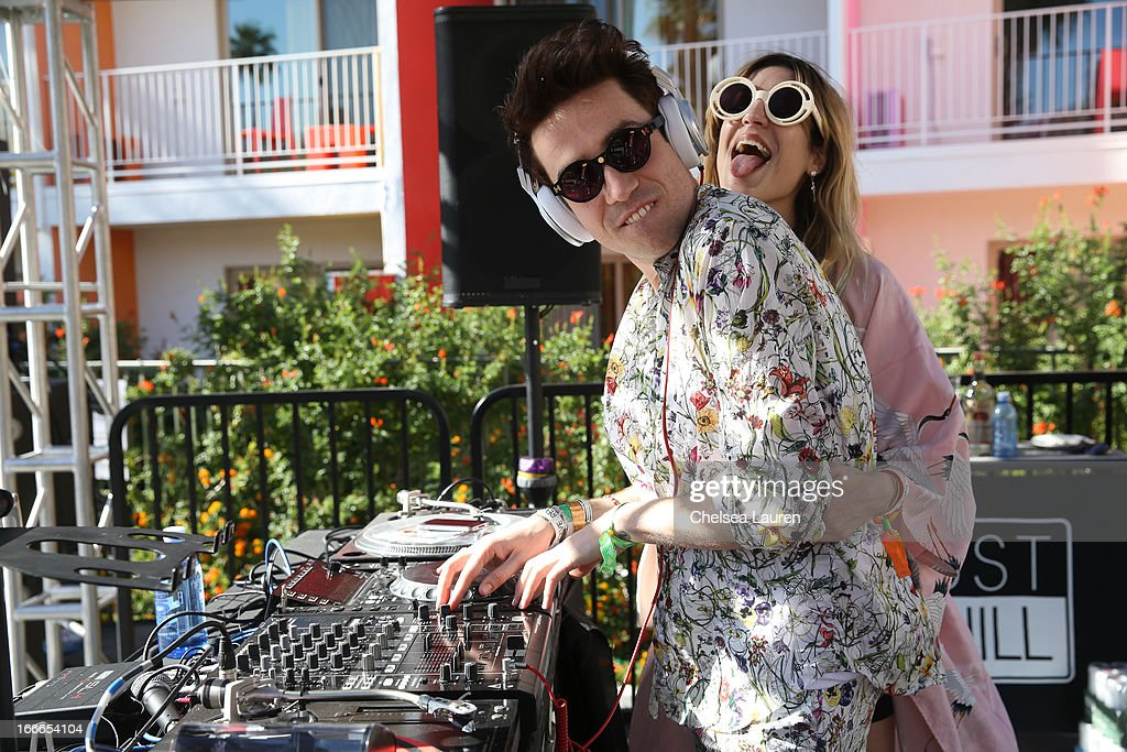 DJ <a gi-track='captionPersonalityLinkClicked' href=/galleries/search?phrase=Nick+Grimshaw&family=editorial&specificpeople=4666727 ng-click='$event.stopPropagation()'>Nick Grimshaw</a> (L) and musician Ioanna Gika attend the House Of Holland eyewear pool party, hosted by Henry Holland and Io Echo, to launch the brand's new collection, in celebration of the Coachella Valley Music & Arts Festival 2013 at Saguaro Hotel on April 14, 2013 in Palm Springs, California.
