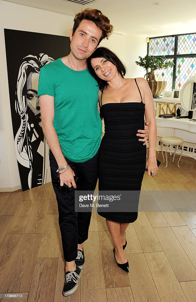 Nick Grimshaw (L) and Sadie Frost attend a first look at a new range of tech accessories for Carphone Warehouse, designed exclusively by Kate Moss for the high street brand, at The Club at The Ivy on July 18, 2013 in London England. The range of smartphone and tablet accessories goes on sale nationwide later this month.