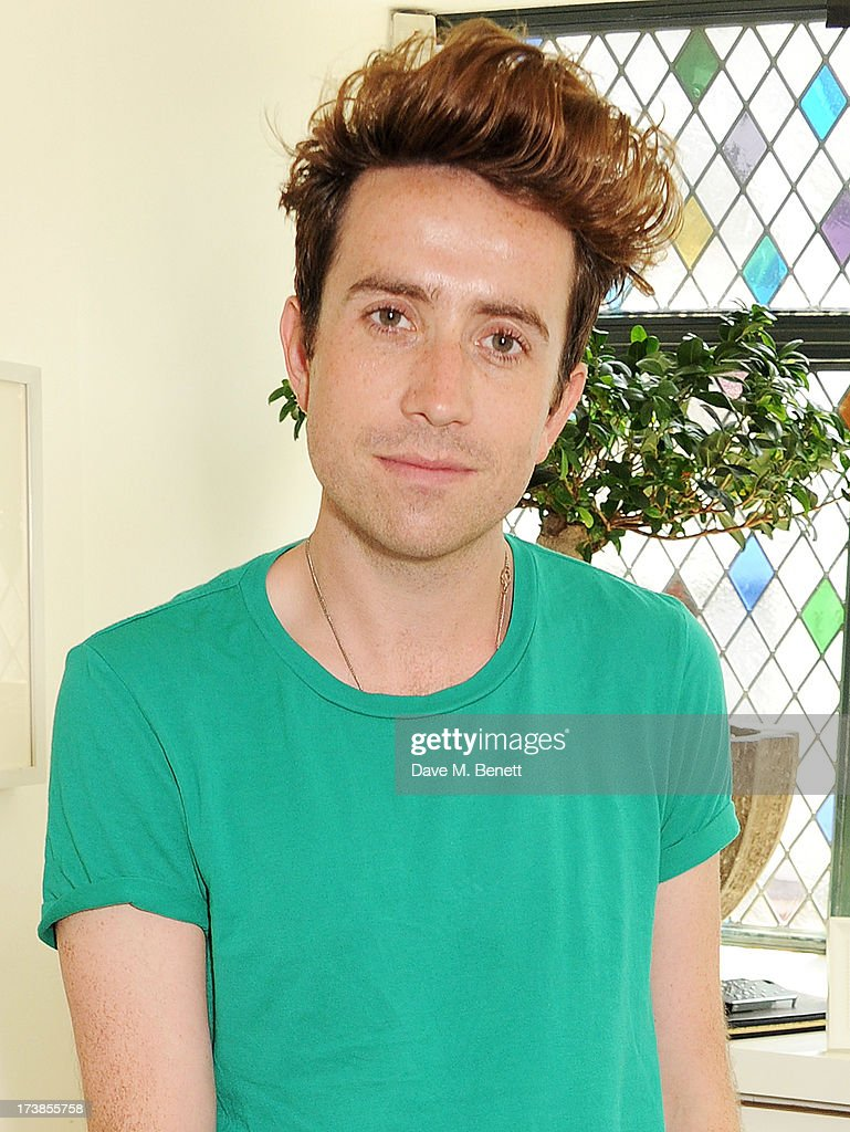 Nick Grimshaw attends a first look at a new range of tech accessories for Carphone Warehouse, designed exclusively by Kate Moss for the high street brand, at The Club at The Ivy on July 18, 2013 in London England. The range of smartphone and tablet accessories goes on sale nationwide later this month.